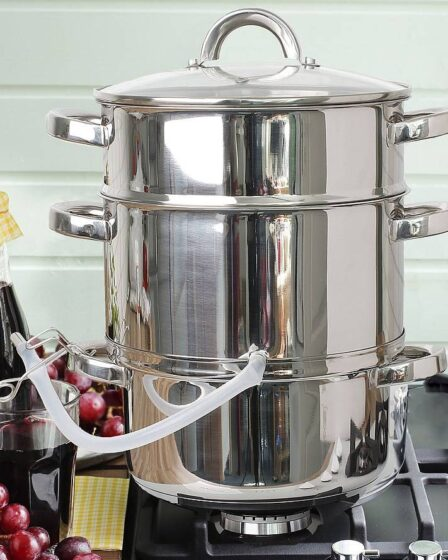 Exprimidor de acero para zumos de frutas