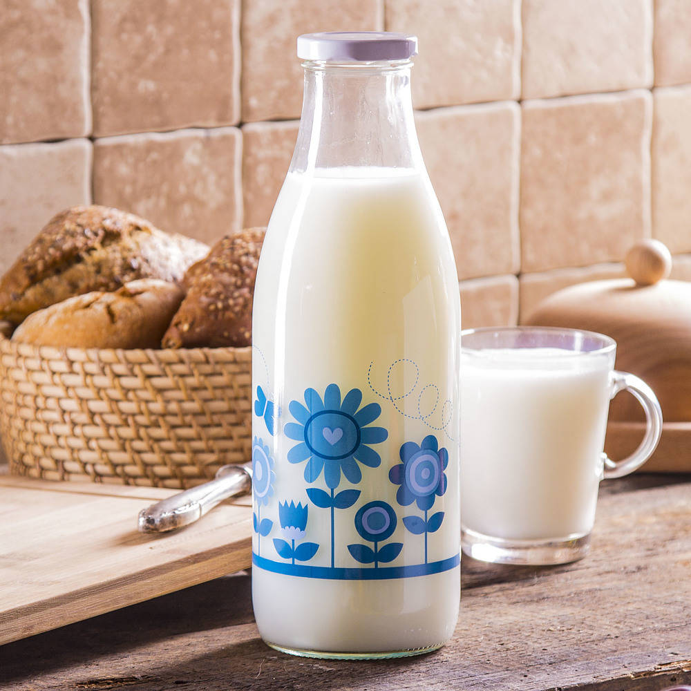 Botella de leche de vidrio