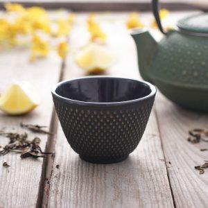 Taza de té de oro de hierro fundido